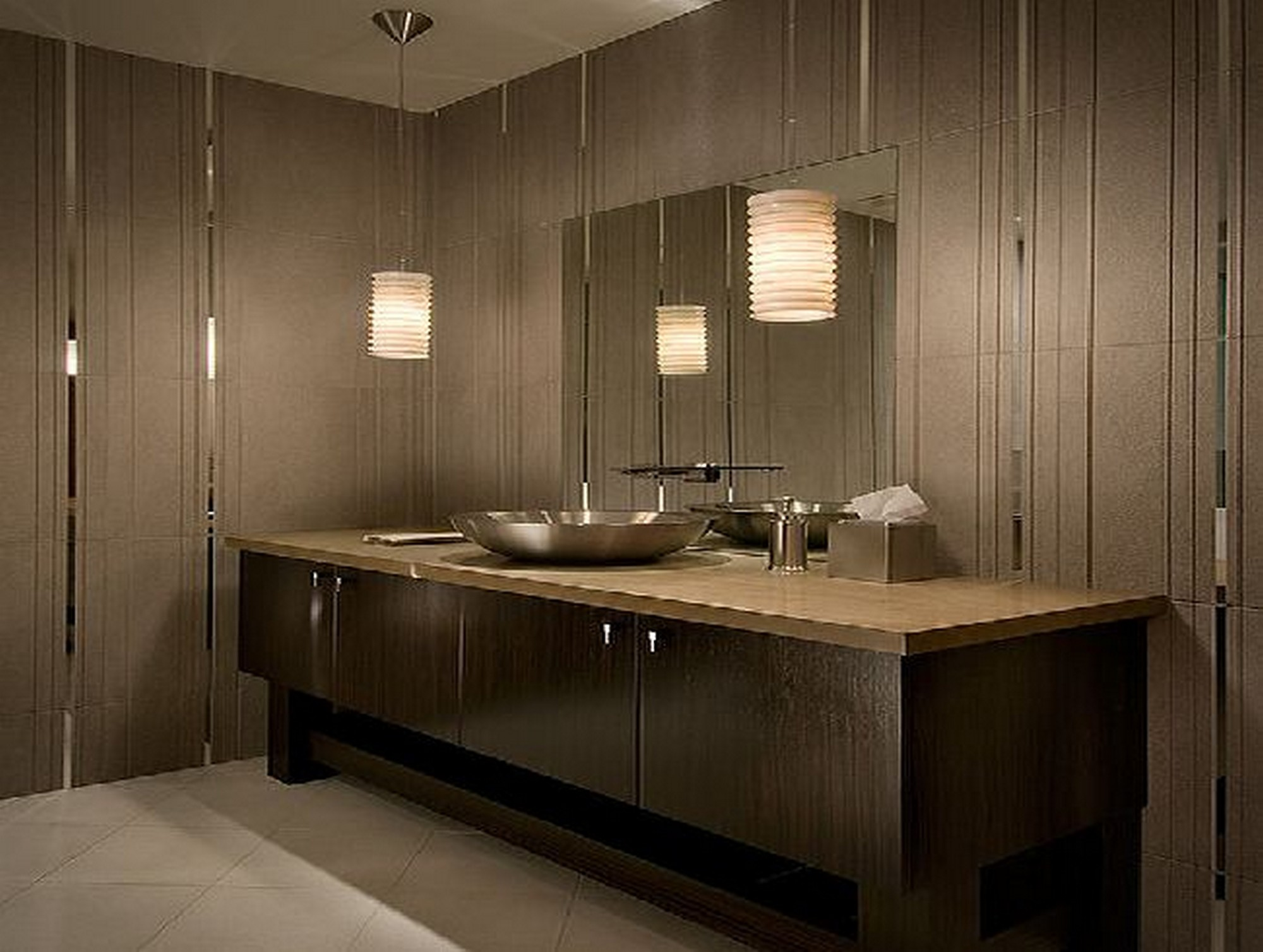 for neutral toned bathroom with two pendant lights in vanity area
