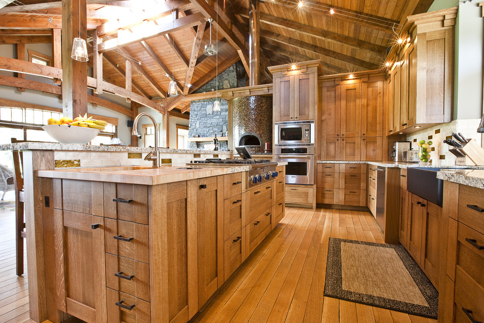 Spacious Look Rustic Kitchen With Oak Cabinets And Island With Barstools
