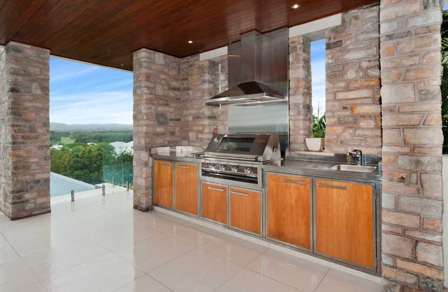 Superbe Stylish Stone And Wood Outdoor Kitchen Coddled With Awesome Green Landscape  View