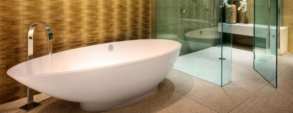 Stylish White Bathtub with Curvy Faucet and Golden Wall Creating the Focal Point of Small Bathroom