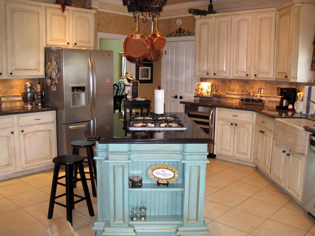 French country kitchens - Surprising Kitchen Layout With Small Blue Island In The Middle Designed In French Country Style