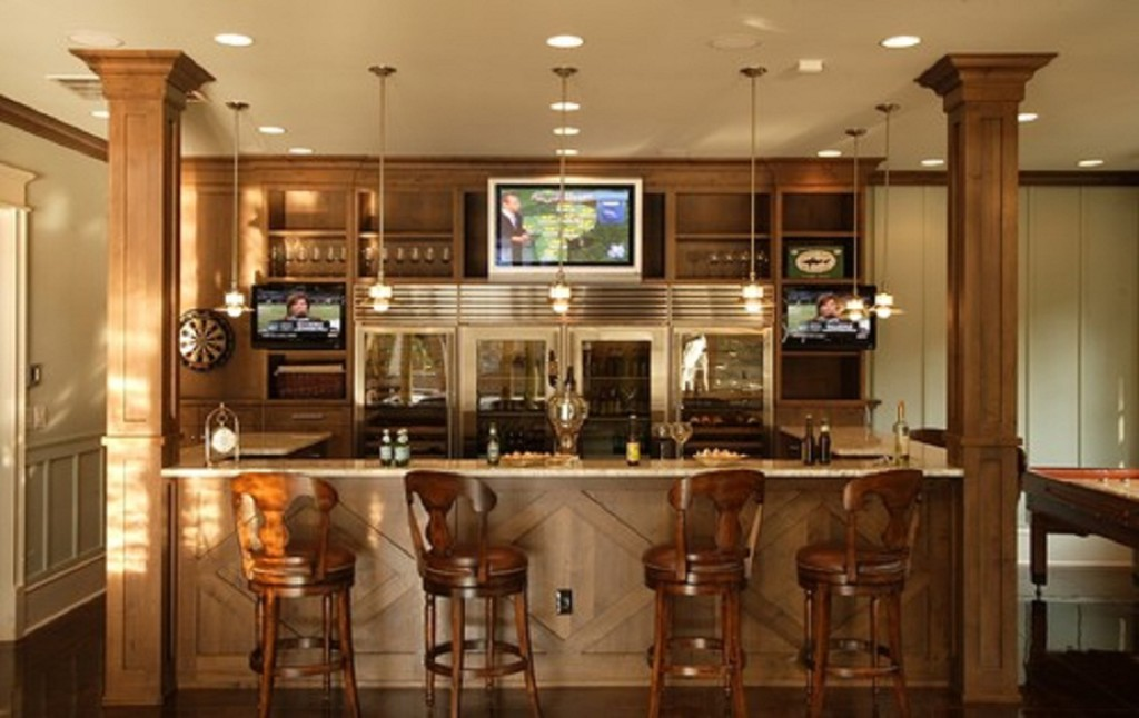Symmetrical Basement Bar Ideas with Three Mounted TVs and Four Stools for Seating