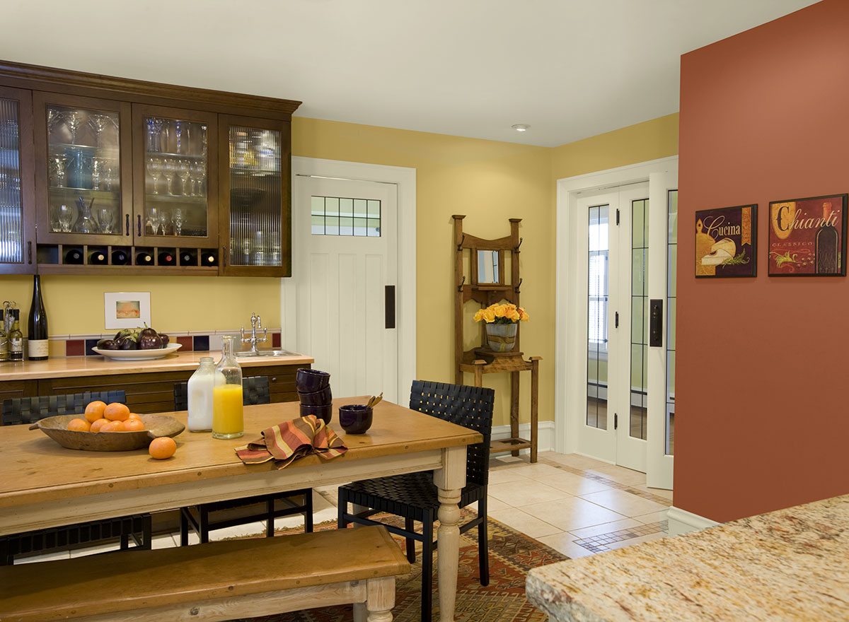 Traditional Kitchen with Nice Yellow and Peach Paint Colors to Meet Wooden Furniture