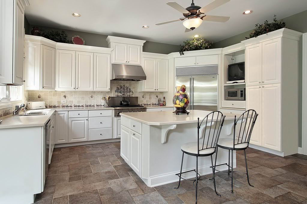 Traditional Patterned White Backsplash Combined with Plain White Kitchen Cabinets and Island
