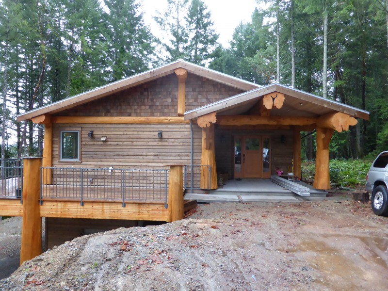 Two Story Tiny House with Huge Logs Architecture and Well Arranged Wood and Shingle