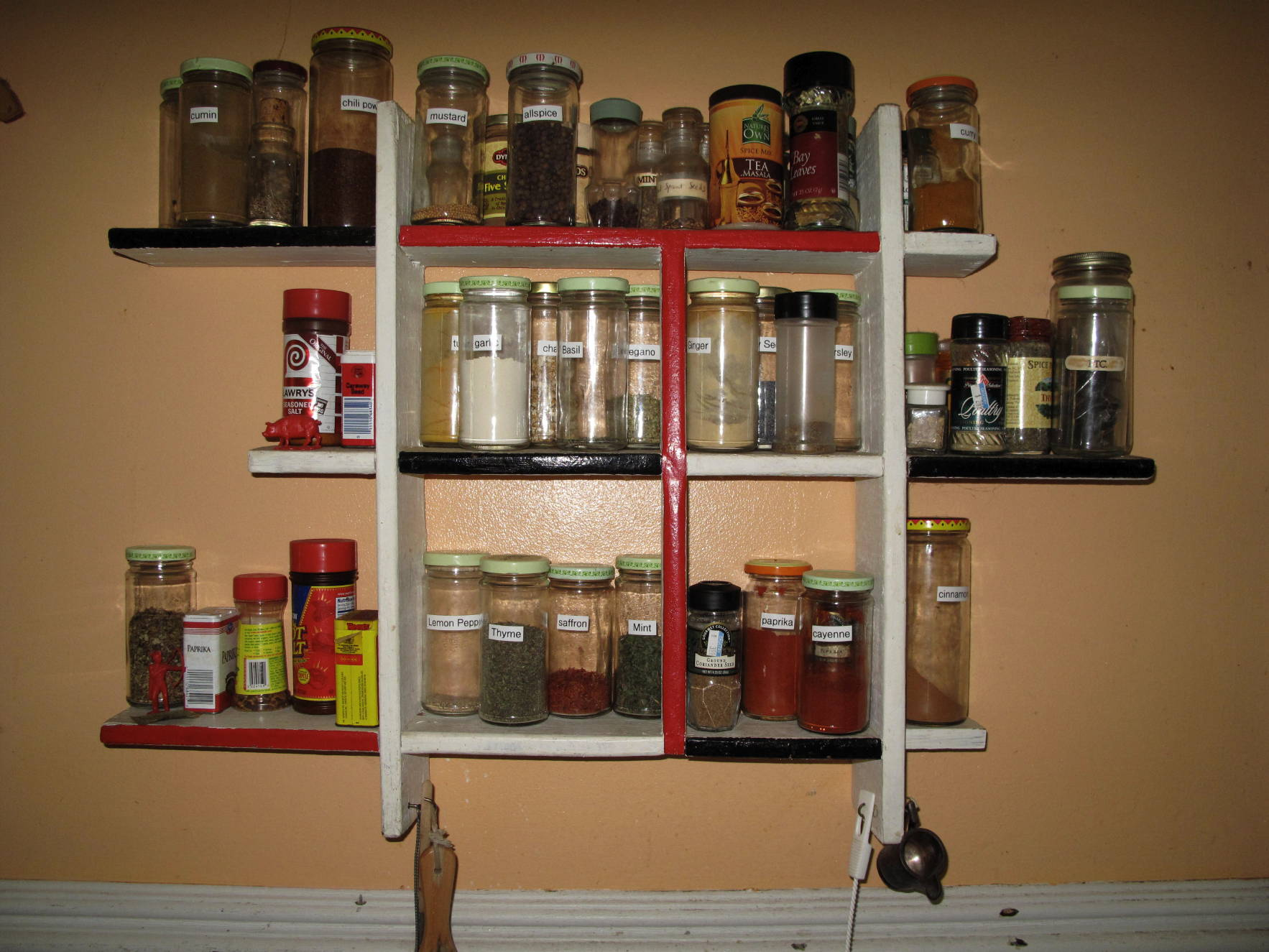 Unique Asymmetrical Spice Rack Painted in Three Colors and Installed on Wall