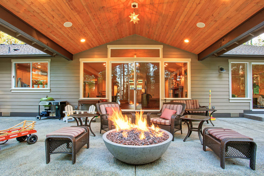 Unique Bowl Fire Pit Surrounded with Benches and Armchairs to Complete Outdoor Patio