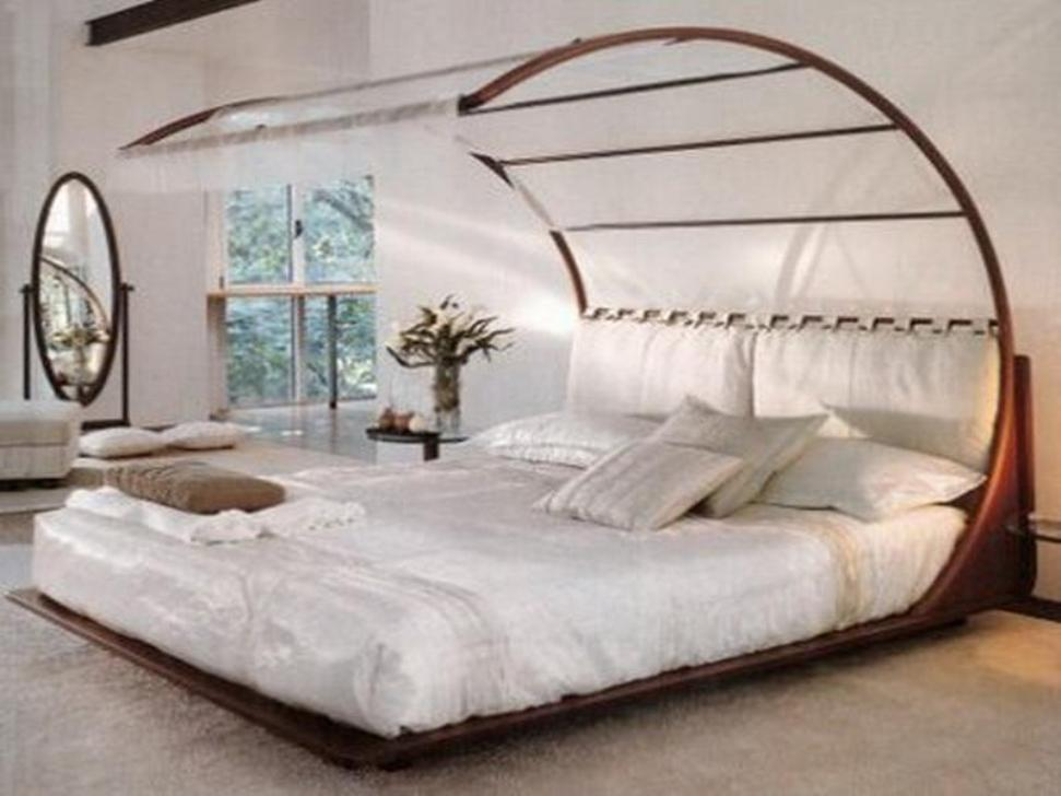 Unique Curve Canopy Bed Frame and White Bedding inside Stunning Bedroom with Oval Floor Mirror