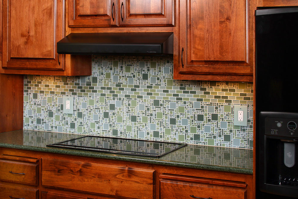 Unpredictable Backsplash Tile Pattern Showing Green and Grey Coloring to Meet Wooden Cabinets