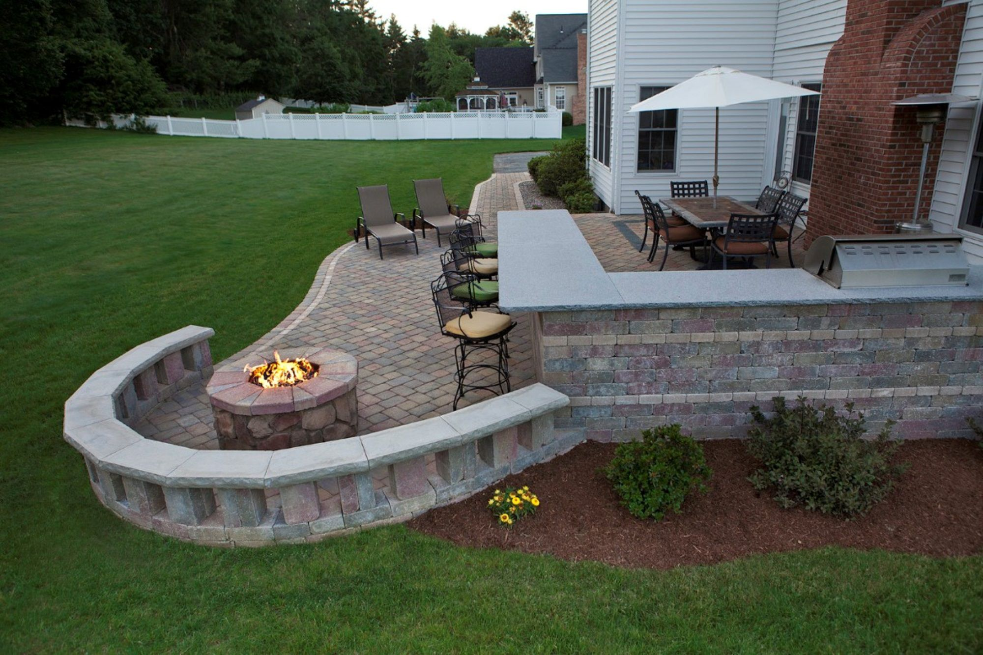 Unusual Curvy Patio Ideas with Well Connected Gathering and Lounge Space with Parasol