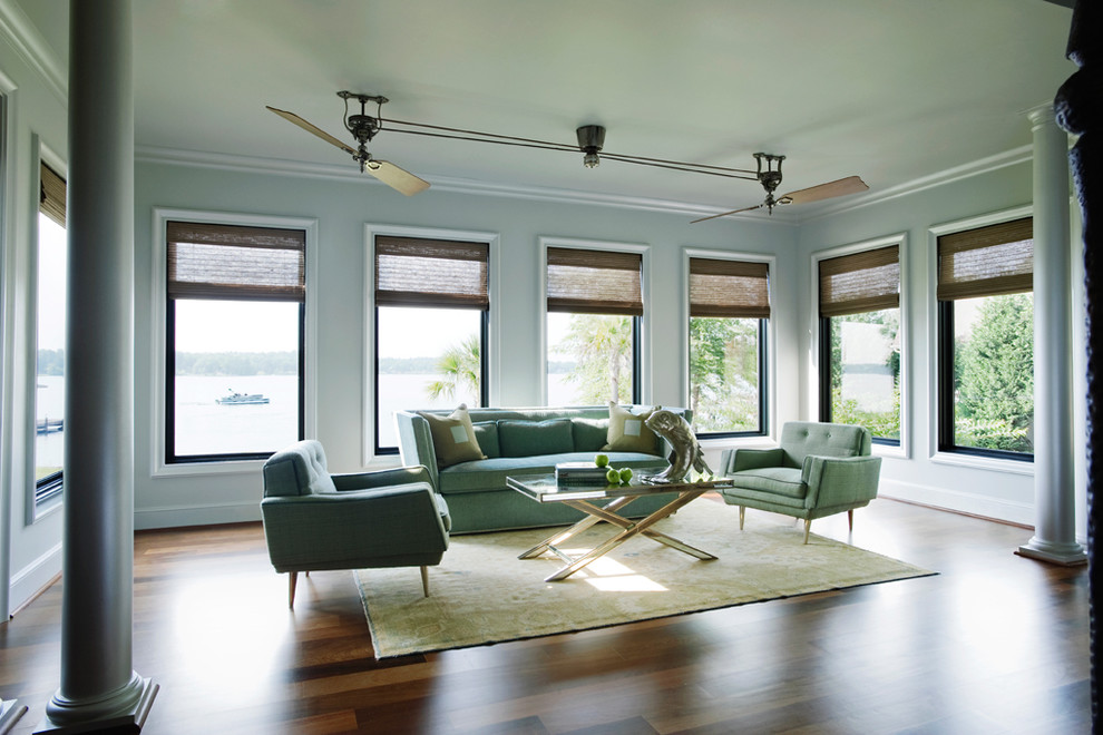 Unusual Design for Modern Ceiling Fans Placed in Wide Living Room with Grey Sofas and Elegant Table
