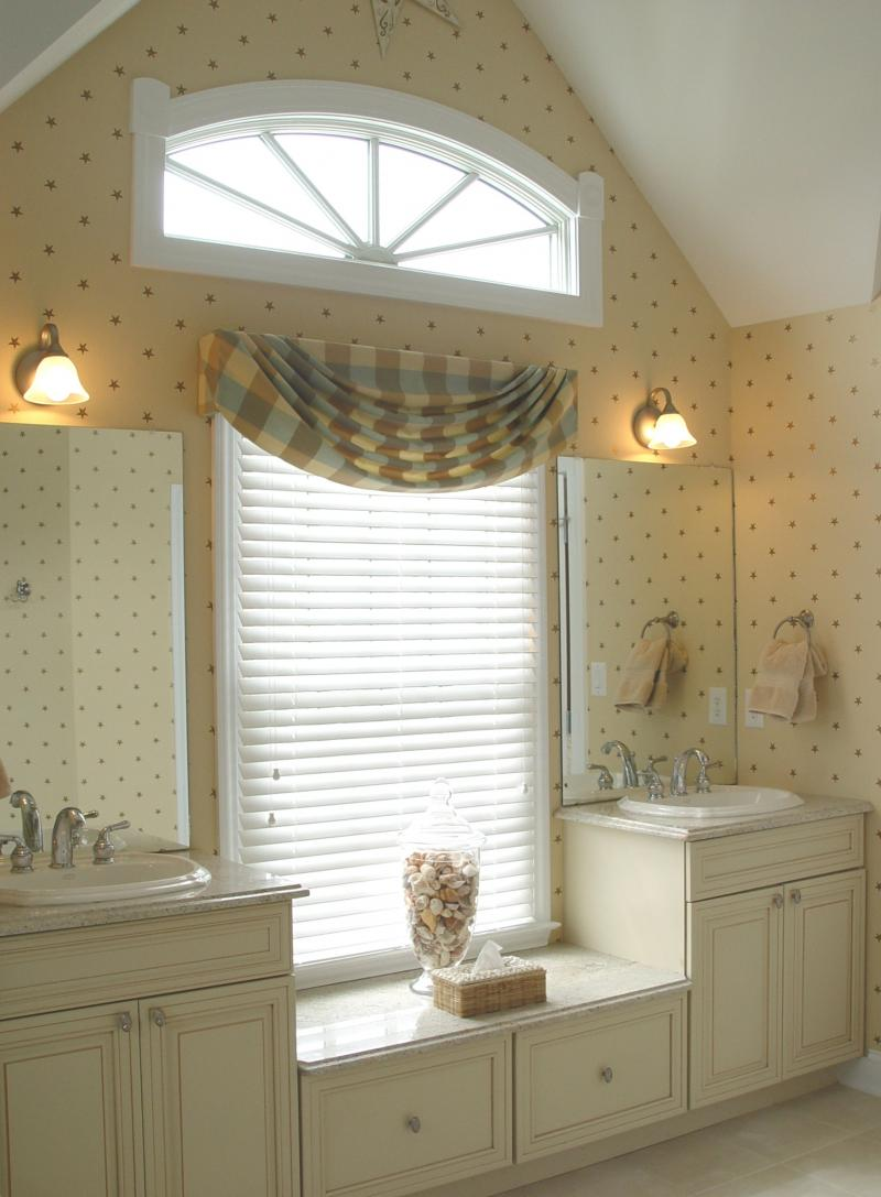 and white vanity in cozy bathroom with simple bathroom window curtains