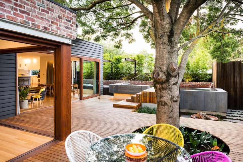 Use Colorful Chairs and Round Glass Top Table in Open Patio as Fall Decorating Ideas with Woden Deck