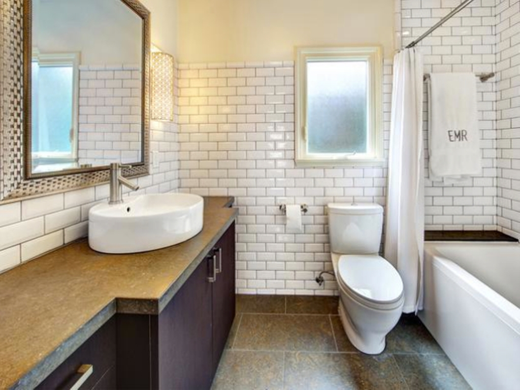 Use Old Fashioned White Subway Tile Wall for Tiny Bathroom with White Bathtub and Long Vanity