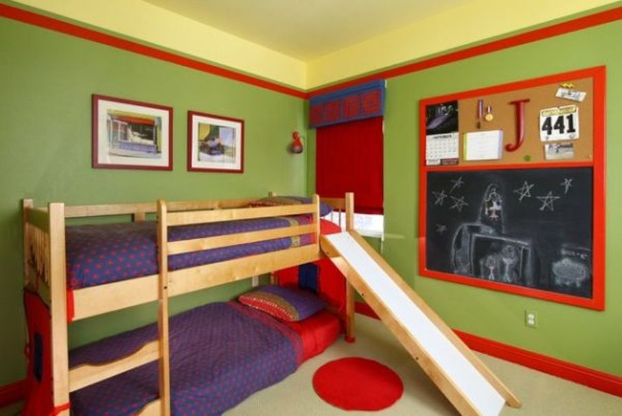 Use Slide for Wooden Toddler Bunk Beds inside Fun Boys Bedroom with Black Board and Red Curtain