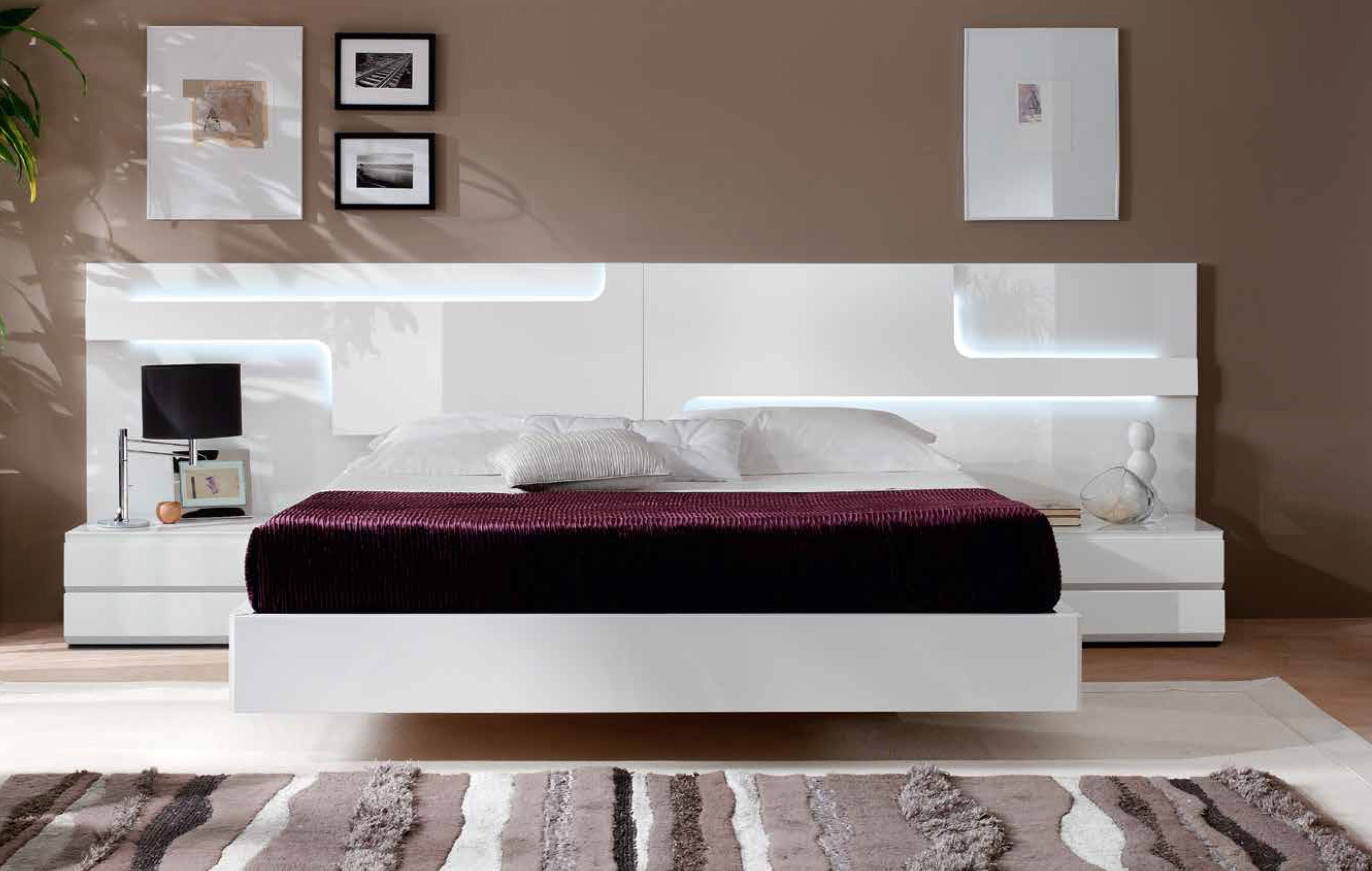 White Floating Bed and Nighstands Used as Modern Bedroom Furniture in Spacious Room with Wide Carpet