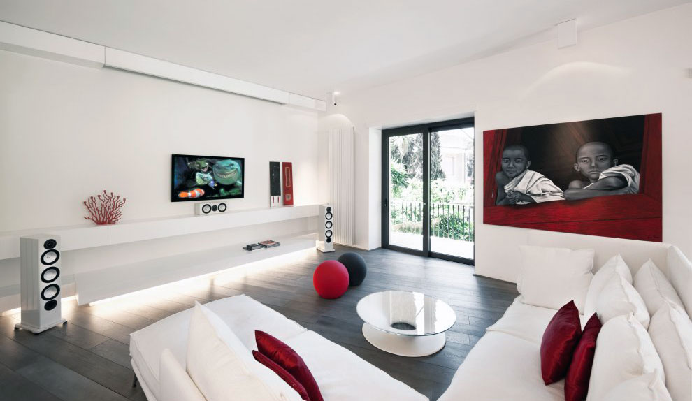 White Modern Living Room with White Painting and Furnishing Decorated with Red Accents