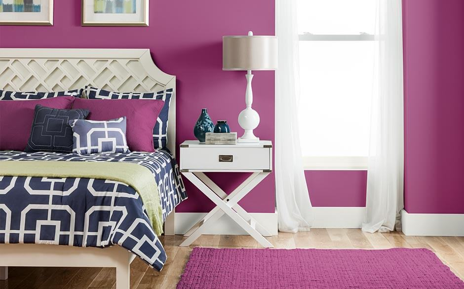 White Nightstand and Table Lamp Placed beside Purple Bedroom Paint Colors on Laminate Flooring
