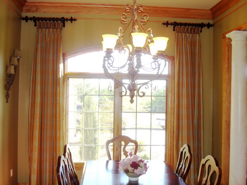 White and Yellow Curtains in Floor Length Design Creating a Focal Point of Traditional Dining Room