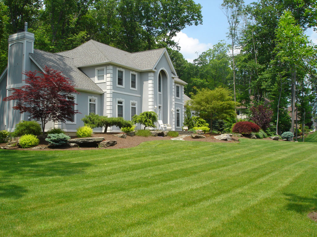 Wide Green Grass Area for Awesome Front Yard Landscaping beside Grey House with White Framed Windows