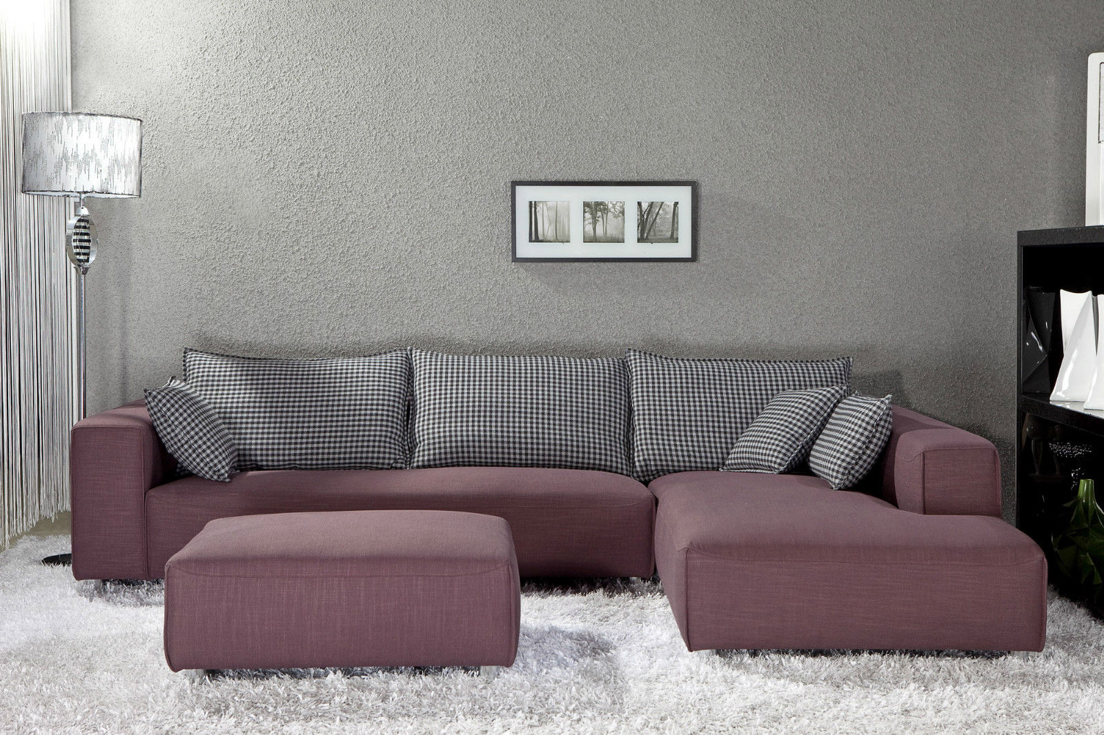 Wide Ottoman and Small Sectional Sofa beside Artistic Floor Lamp on White Carpet Rug
