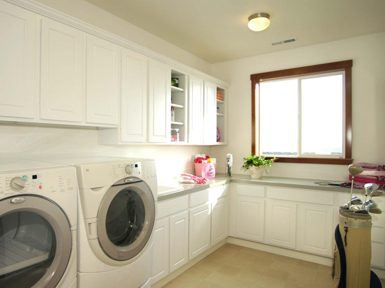 Wood Framed Glass Window Installed Inside Clean Laundry Room Ideas With  Long Counter And White Cabinets