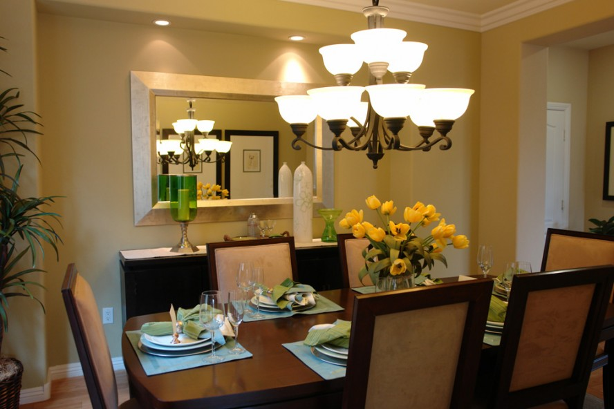 Yellow Decorative Flowers On Oak Table Inside Small Dining Area Using Bright Room Chandeliers