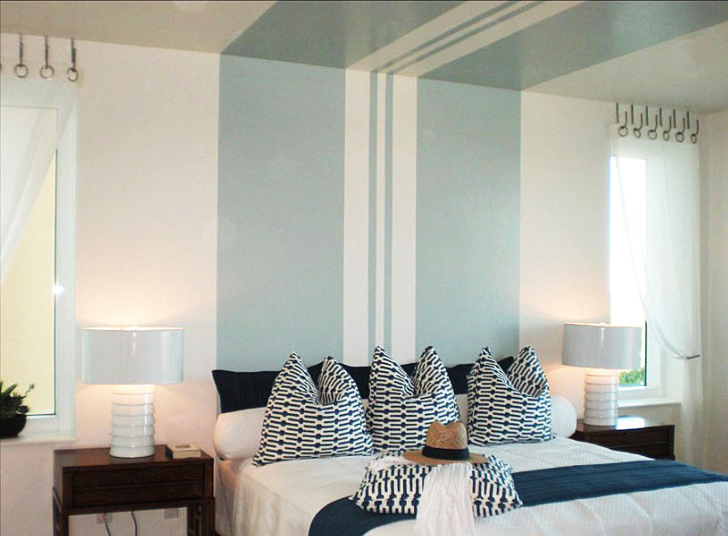 Add Blue Details on White Bedroom Paint Ideas for Wide Room with Fluffy Bed and Wooden Nightstands
