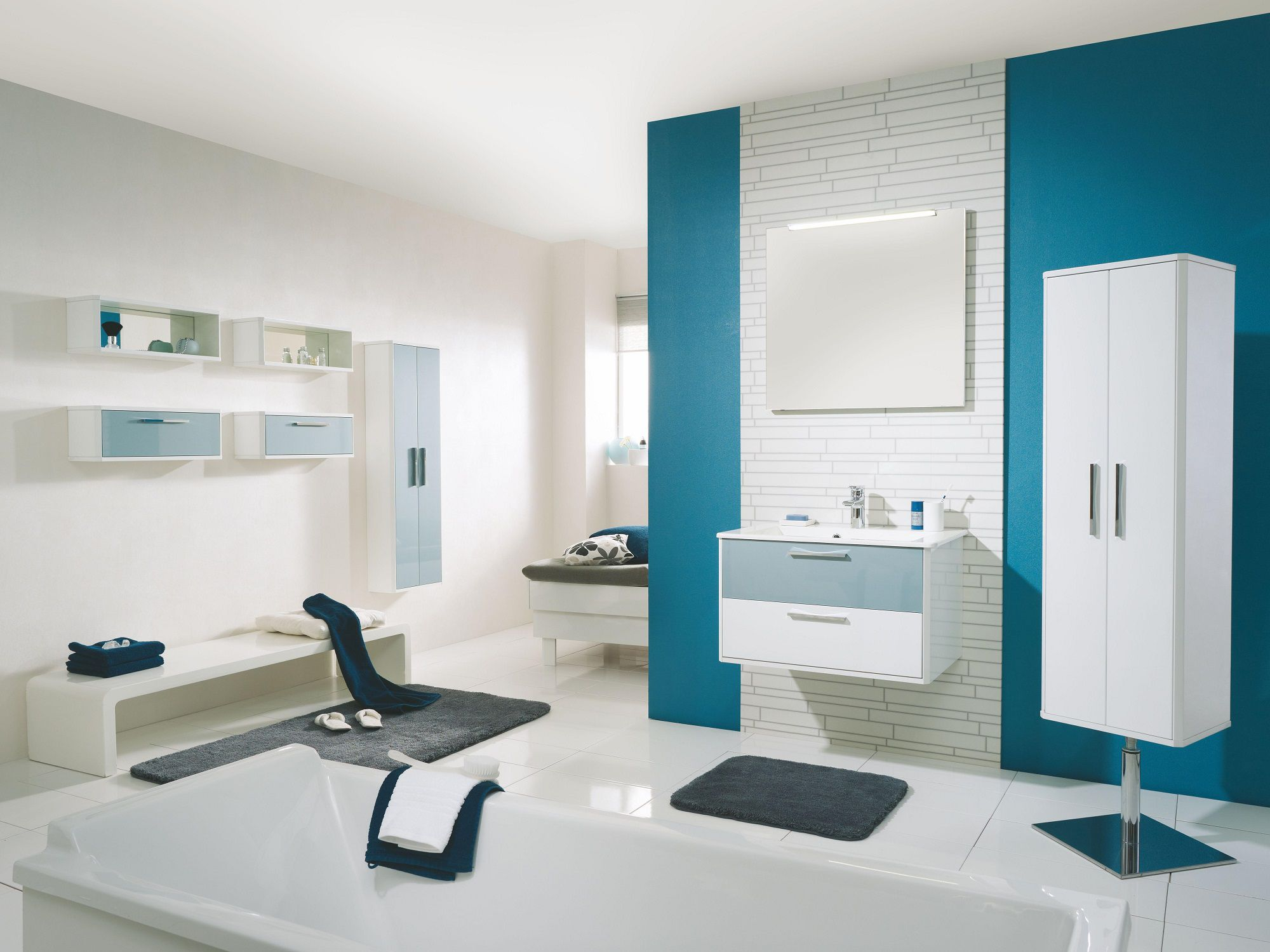 add blue interior paint colors inside white bathroom with floating vanity and bathtub