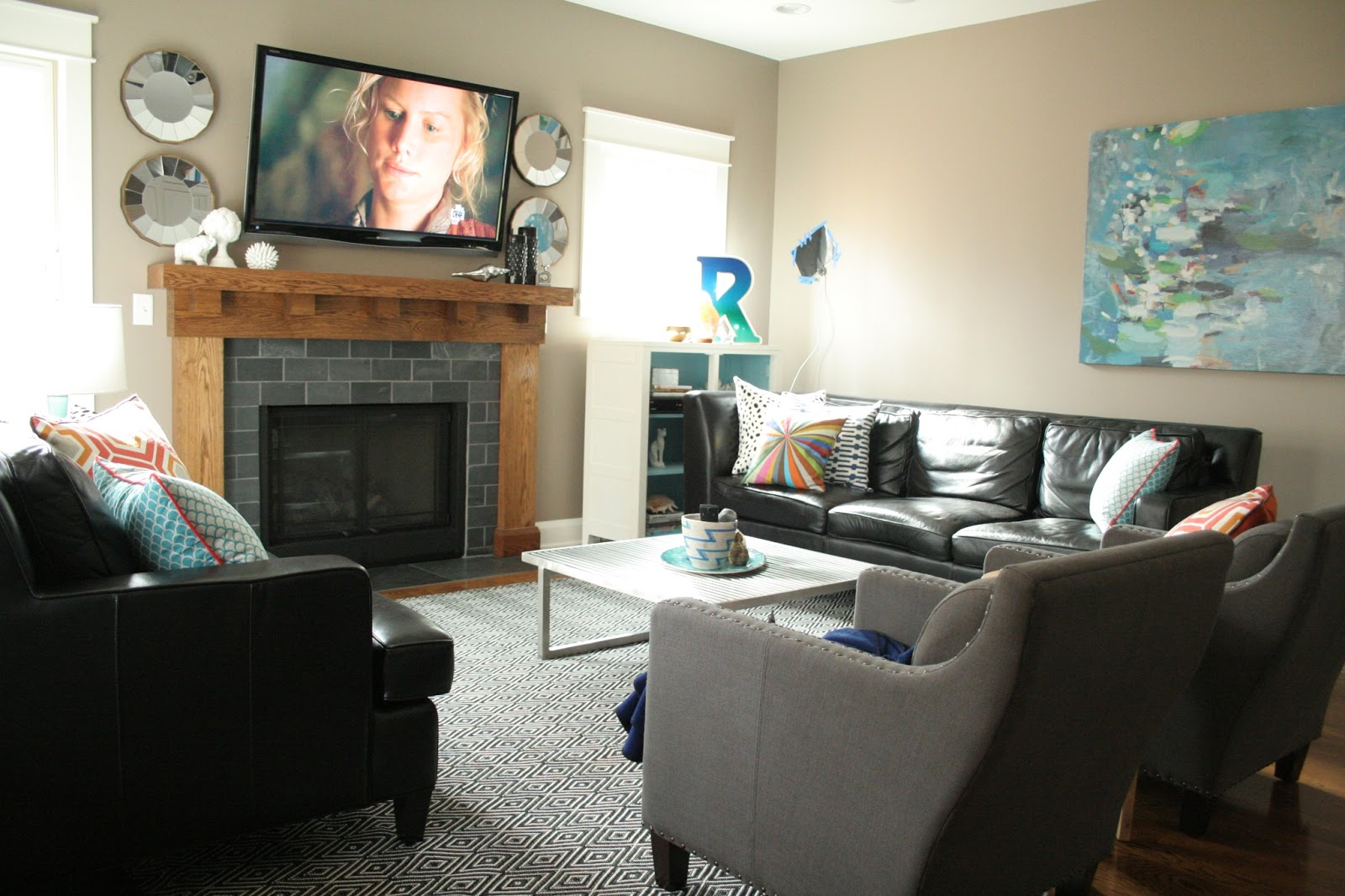 Add Wooden Mantel Piece for Grey Stone Fireplace inside Traditional Living Room Layout with Leather Sofas
