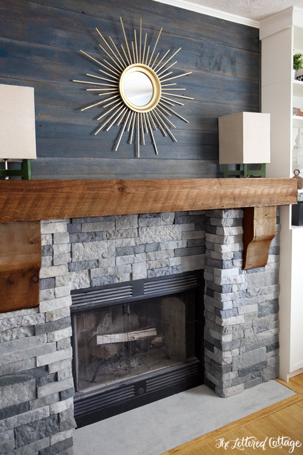 Genial Alluring Sun Artwork Above Faux Stone Fireplace With Chic Color And Wooden  Accent