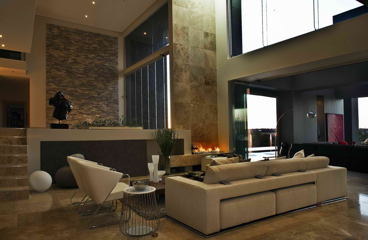 Amazing Contemporary Living Room Design with Sectional Sofa and Stylish Chairs facing Low Coffee Table