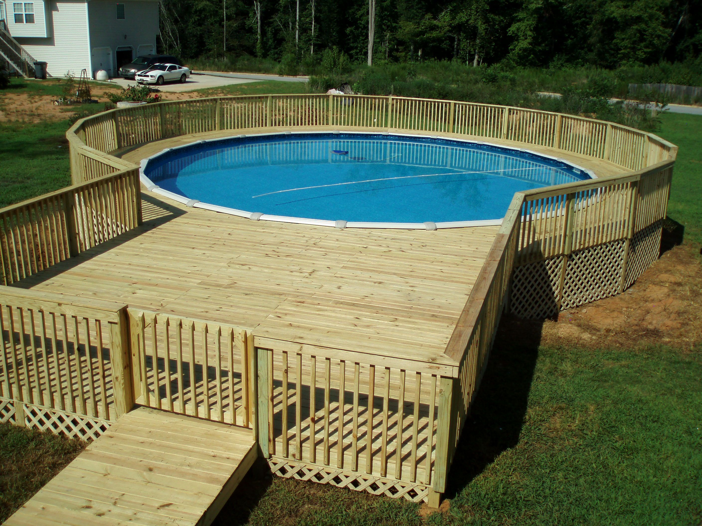 Amazing Design Pool Deck Ideas with Great Wooden Element on Large Green Grass