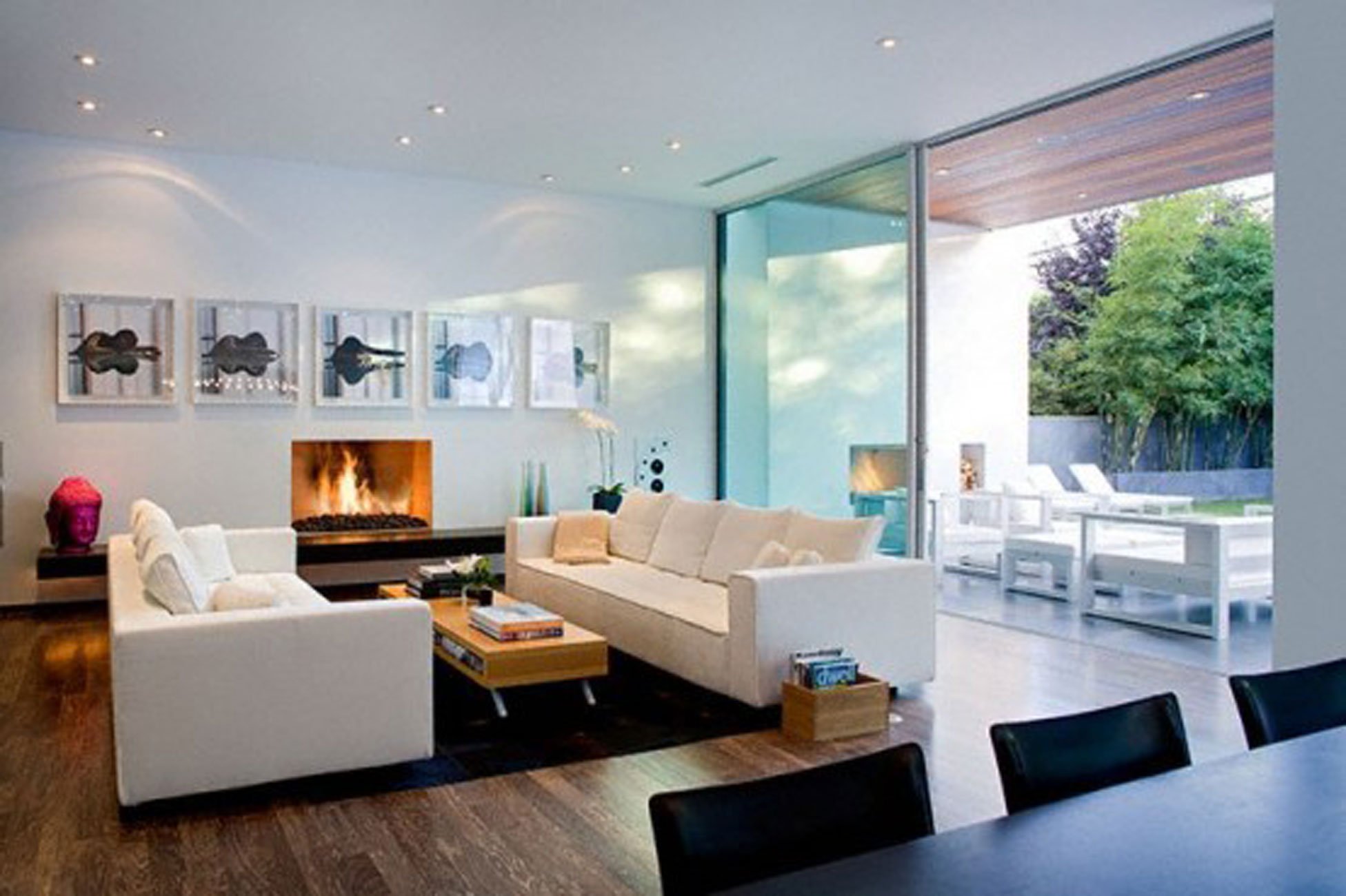Amazing Modern Interior Design in Family Room with White Sofas and Low Table near Stunning Fireplace