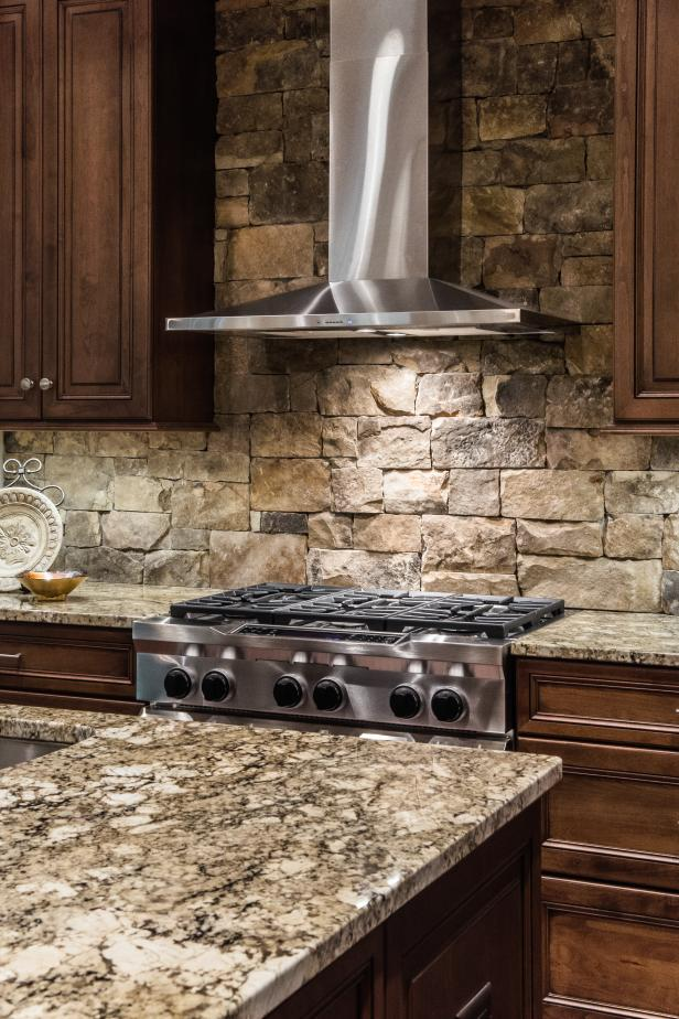Amazing Picture for Stacked Stone Backsplash close Metal Tubular Stove facing Granite Countertop