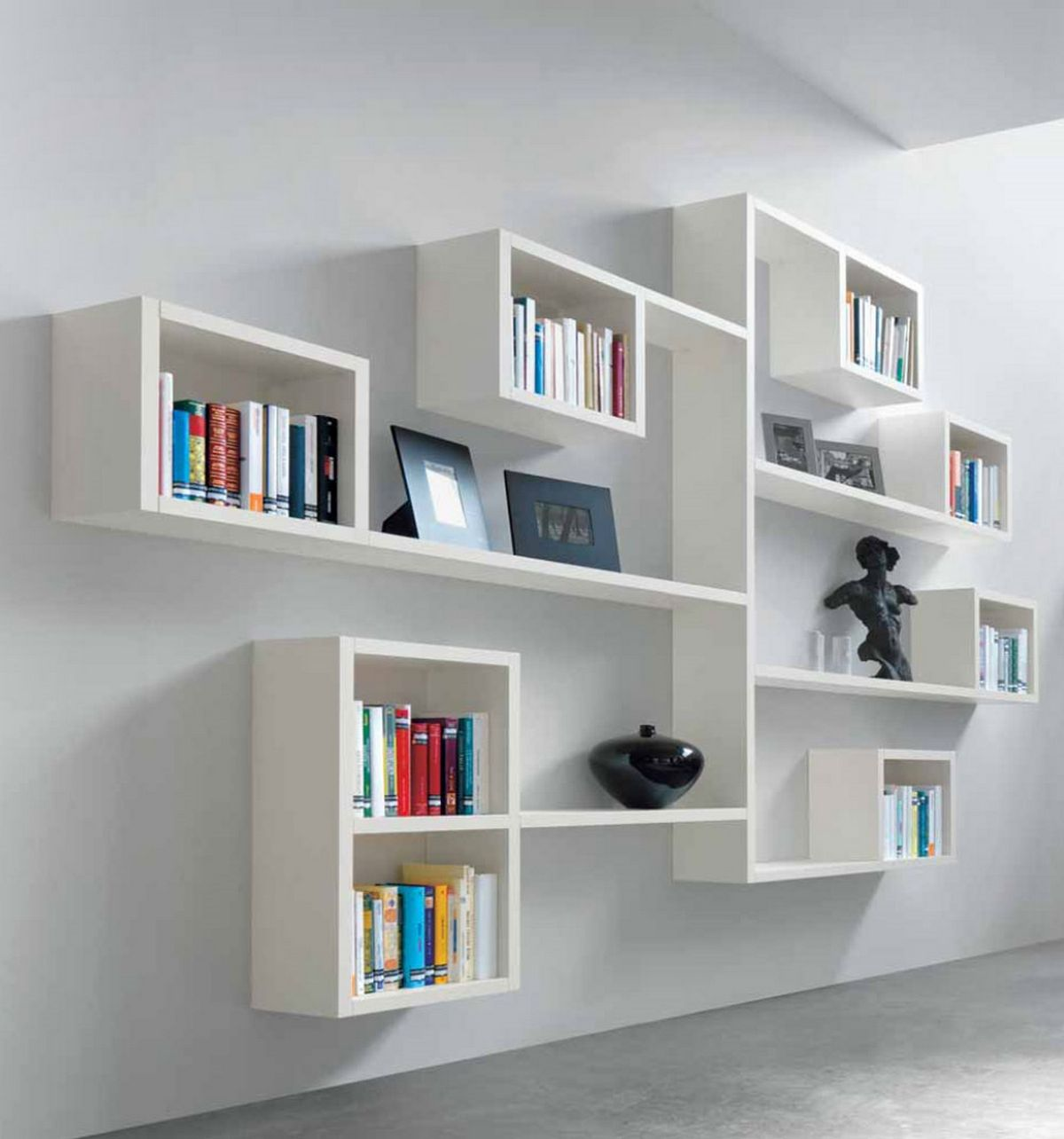 Amazing Sitting Room Interior with Stylish White Oak Wall Mounted Bookshelves on Clean Painted Wall