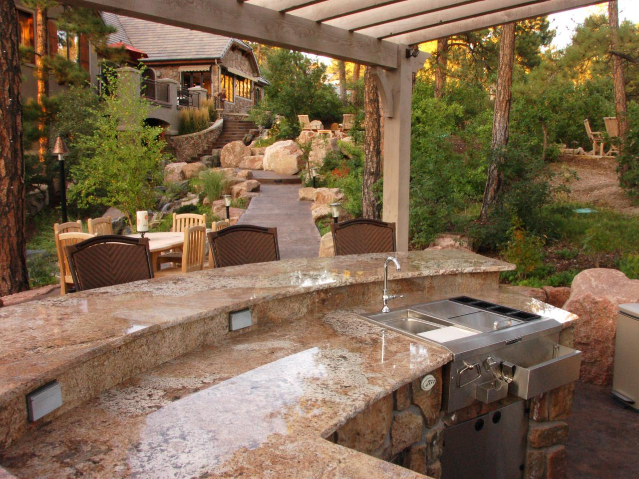 Appealing Outdoor Kitchen Plans With Stone Counter And Glossy Sink Under  Oak Pergola