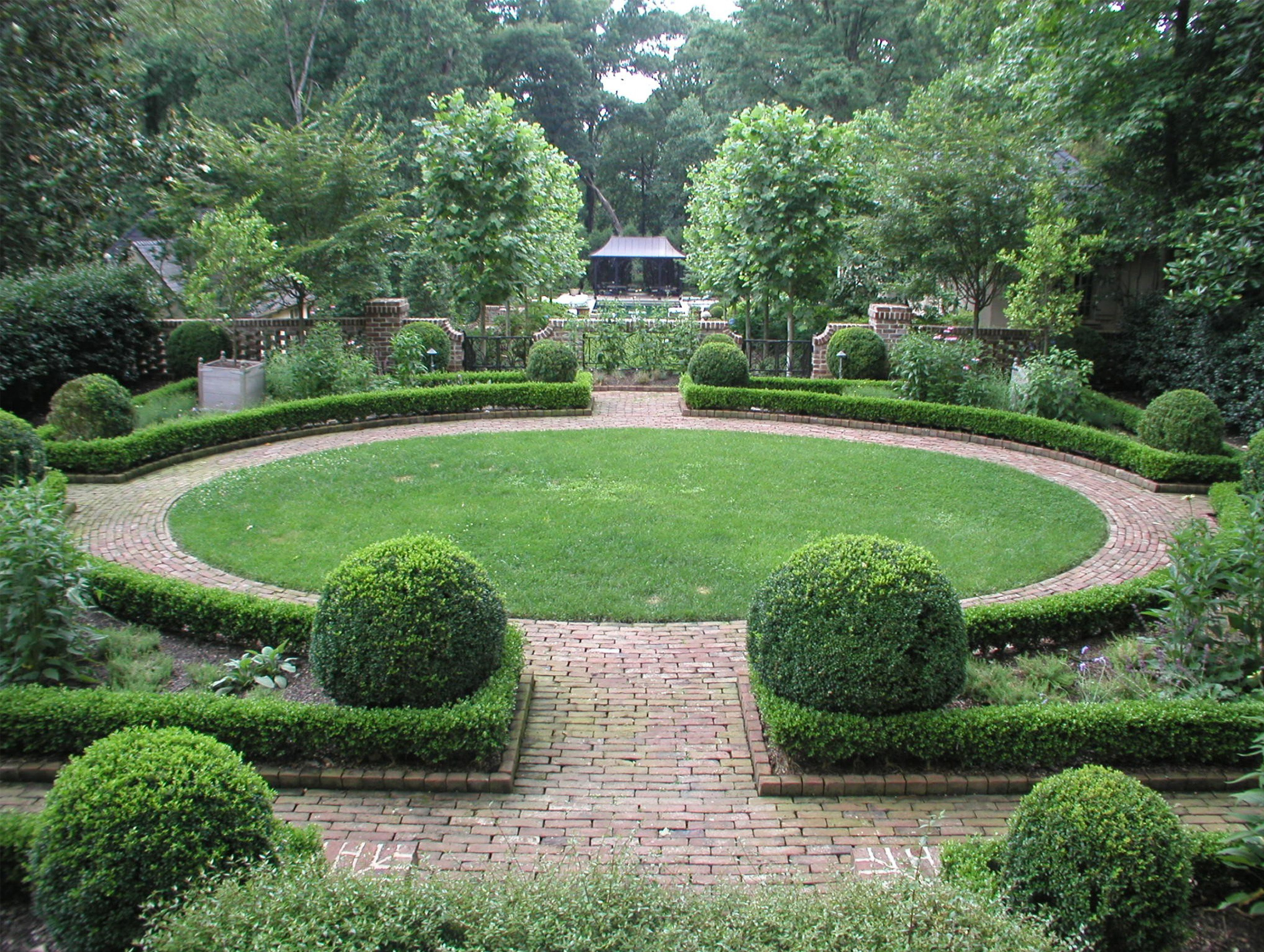 Attractive Backyard Landscape Design Ideas in Round Shape with Brick Path also Green Plants