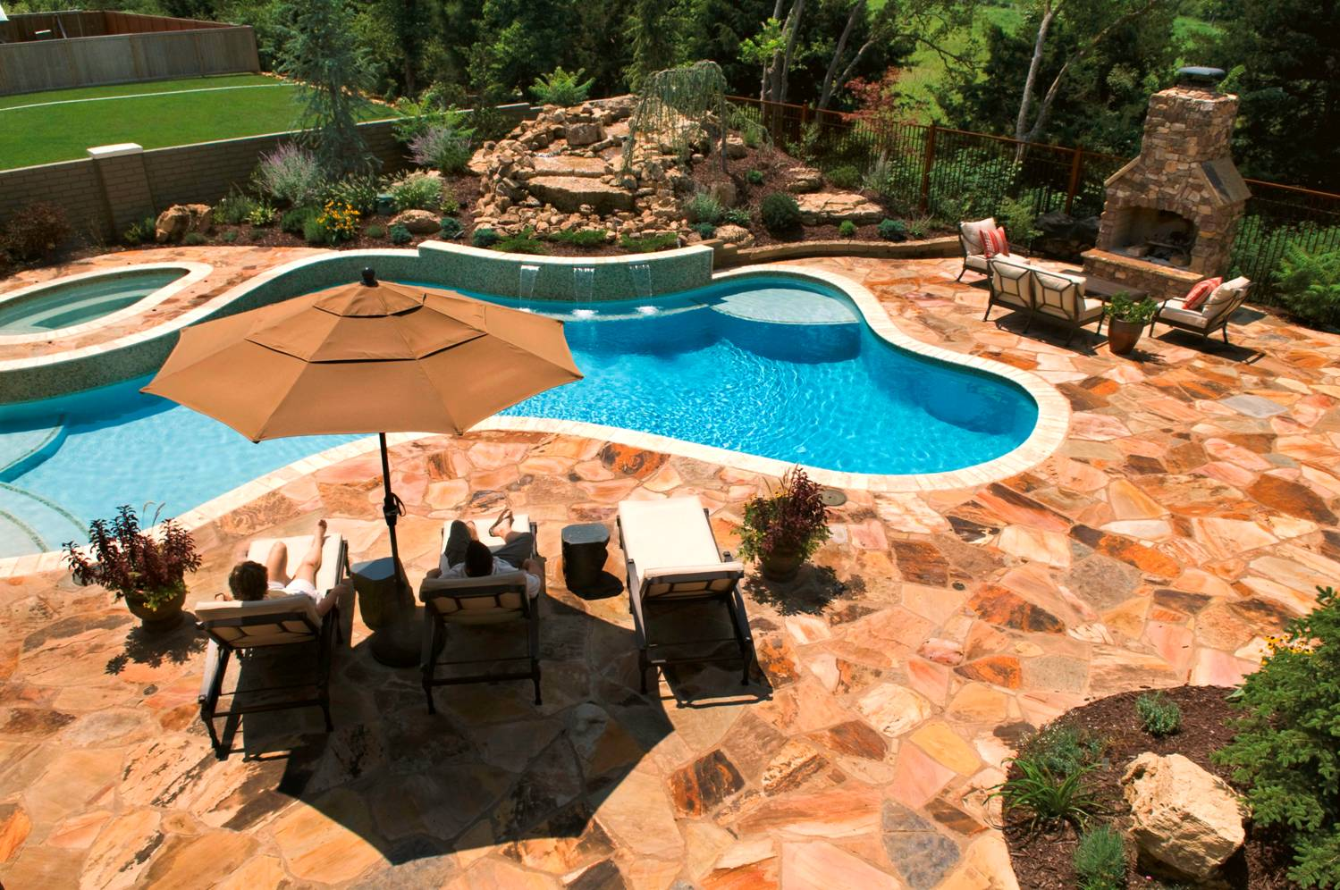 Attractive Decorating for Large Pool Deck Ideas with Best Stone