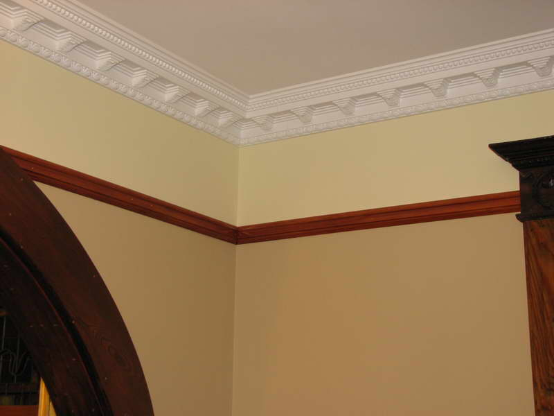 Ceiling Molding Design Ideas color experts generally suggest reinforcing a warm wall color like peach or marigold with Attractive White Crown Molding Ideas For Clean Ceiling Inside Old Fashioned Room With Curve Oak Door