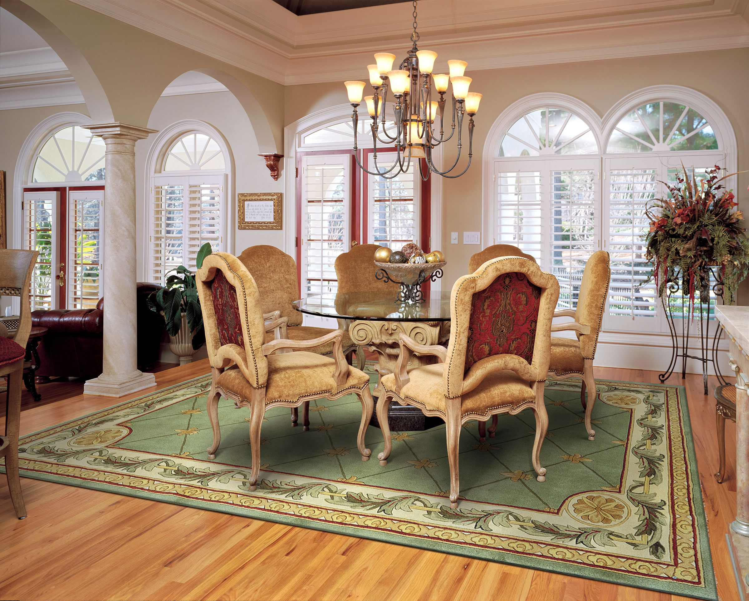 Awesome Dining Room Rugs in Classic Dining Room with Round Glass Top Table and Elegant Chairs