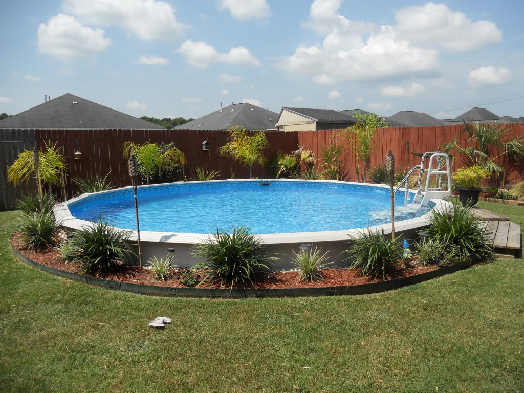 Awesome View in Pool Deck Ideas with Fresh Plant and High Wooden Fence
