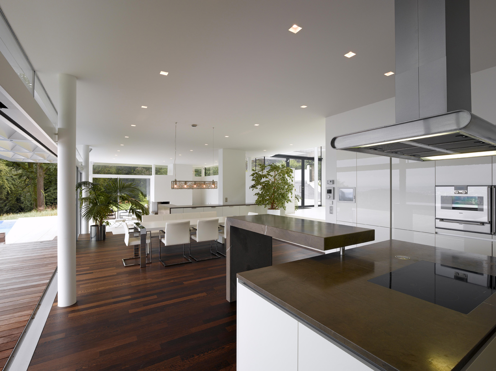Awesome White Island and Additional Table inside Modern Open Kitchen Design facing White Dining Table Set