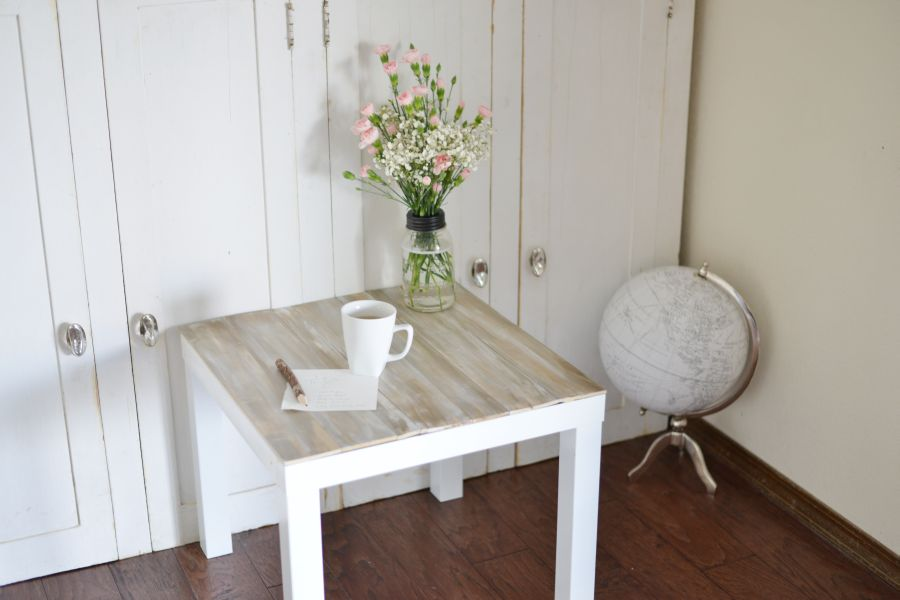 Beaitifull Flower on White Beside Table with Best Oaken Accent close Big Wardrobe