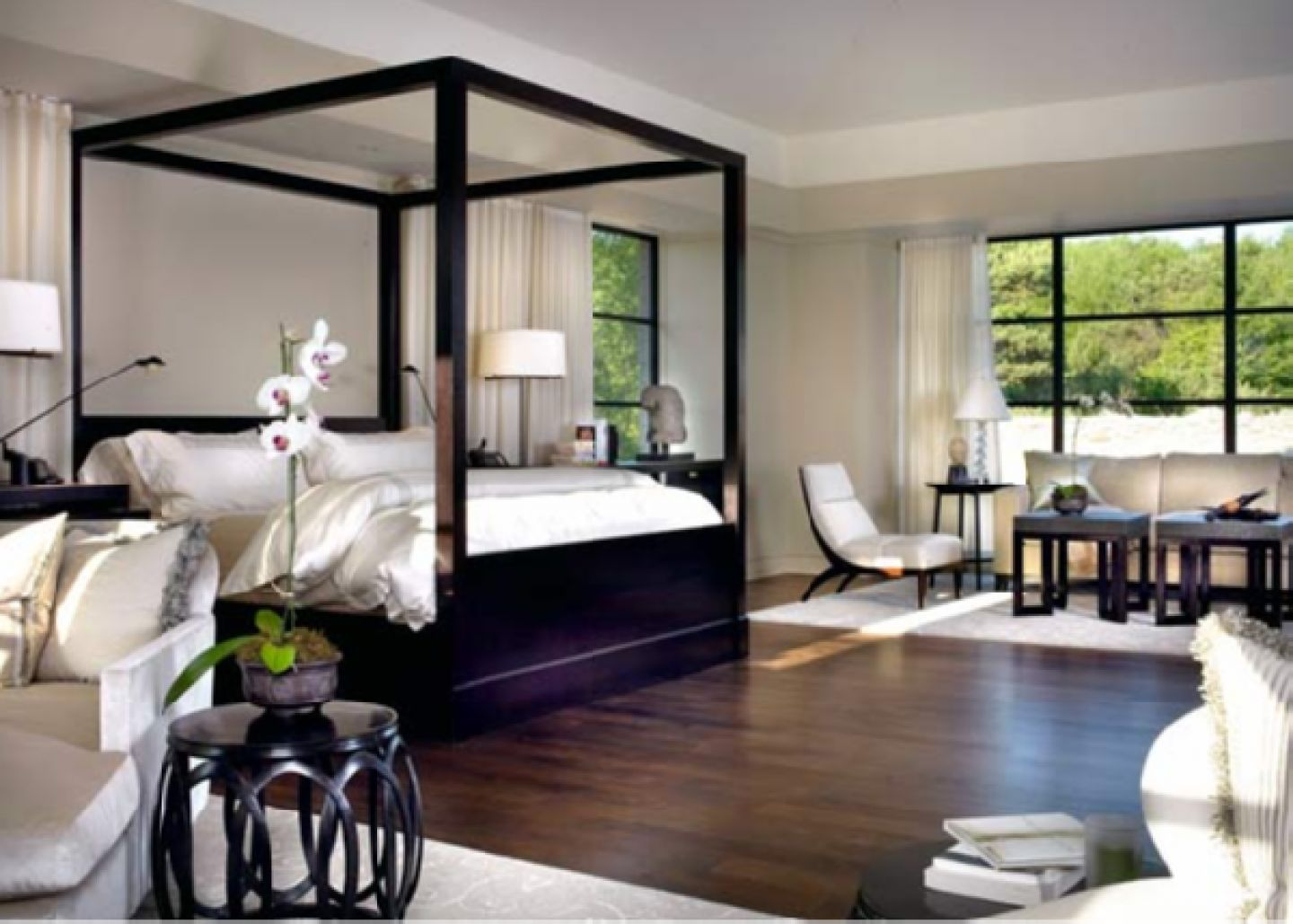 Black Canopy Bedroom Sets and White Bedding Placed inside Cozy Bedroom with Fluffy Sofas and Dark Tables