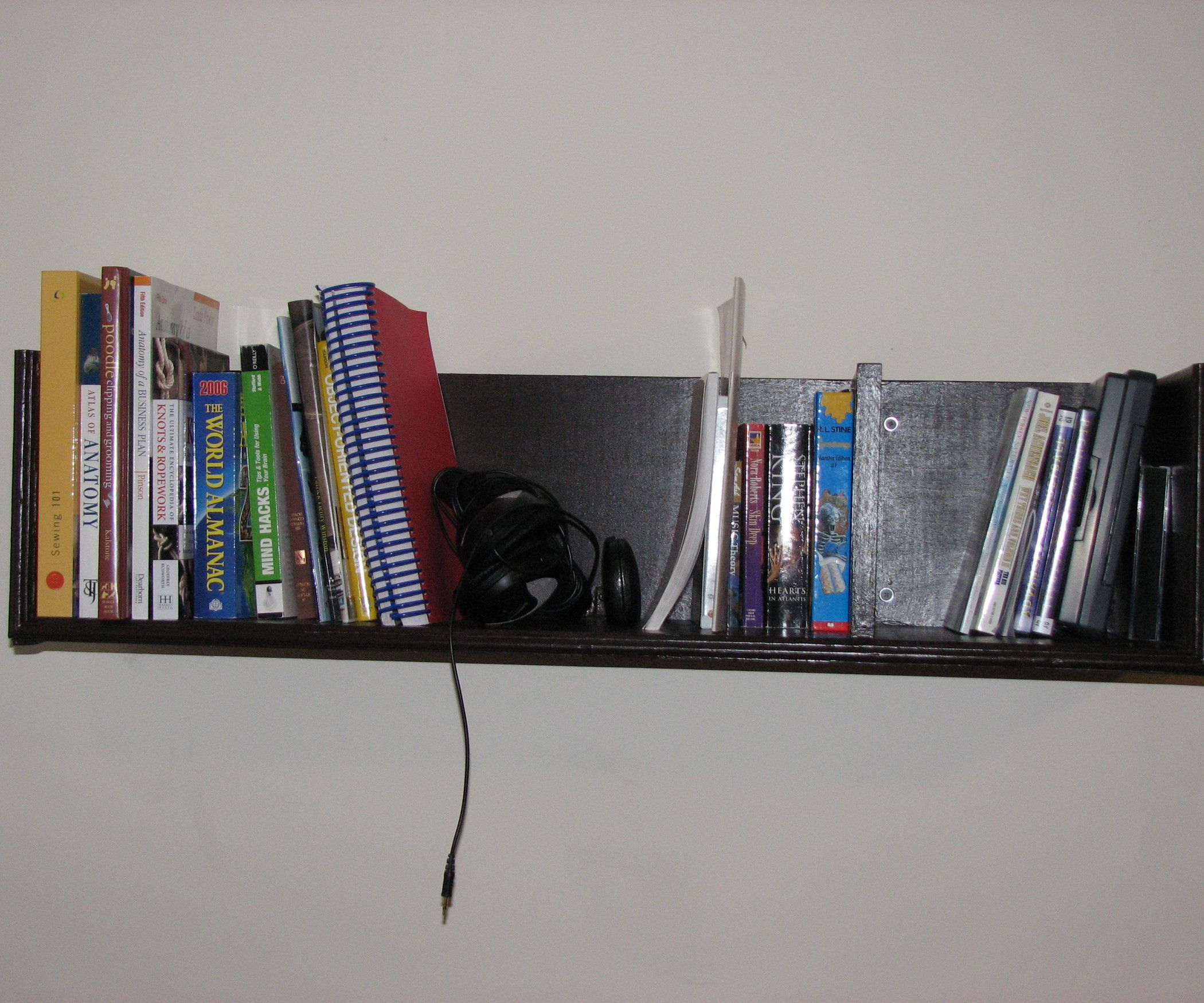 Bon Black Wall Mounted Bookshelves Placed On White Painted Wall For Minimalist  Sitting Room