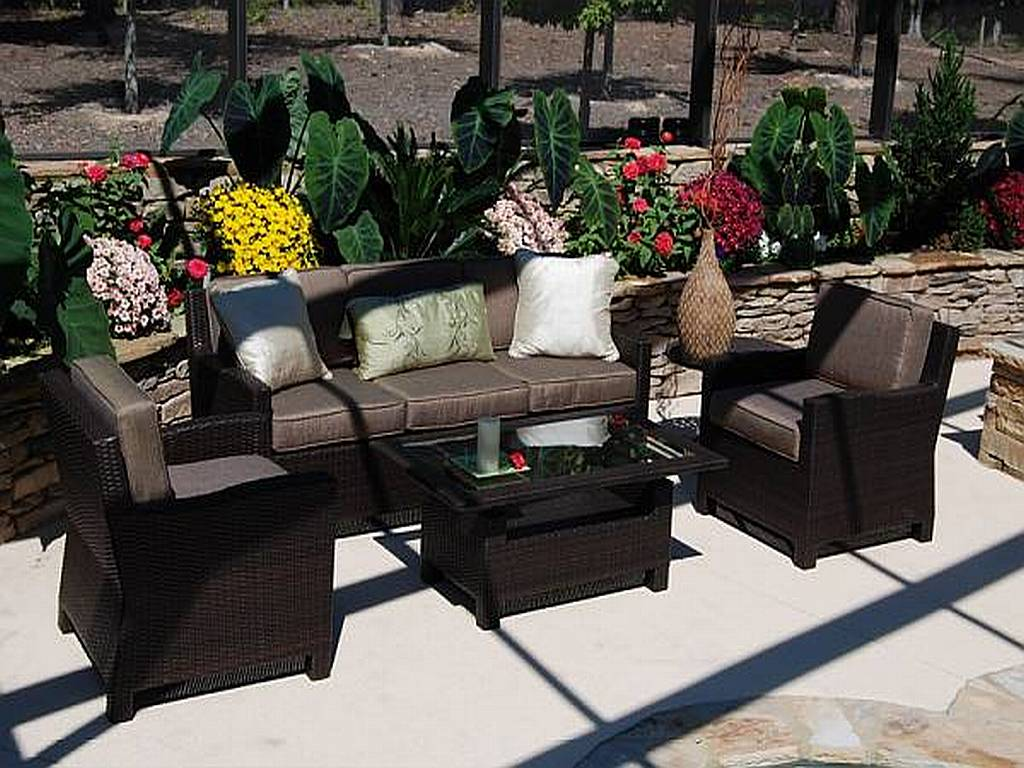 Black Wicker Table and Sofas Used for Modern Patio Furniture in Minimalist Patio with Concrete Flooring