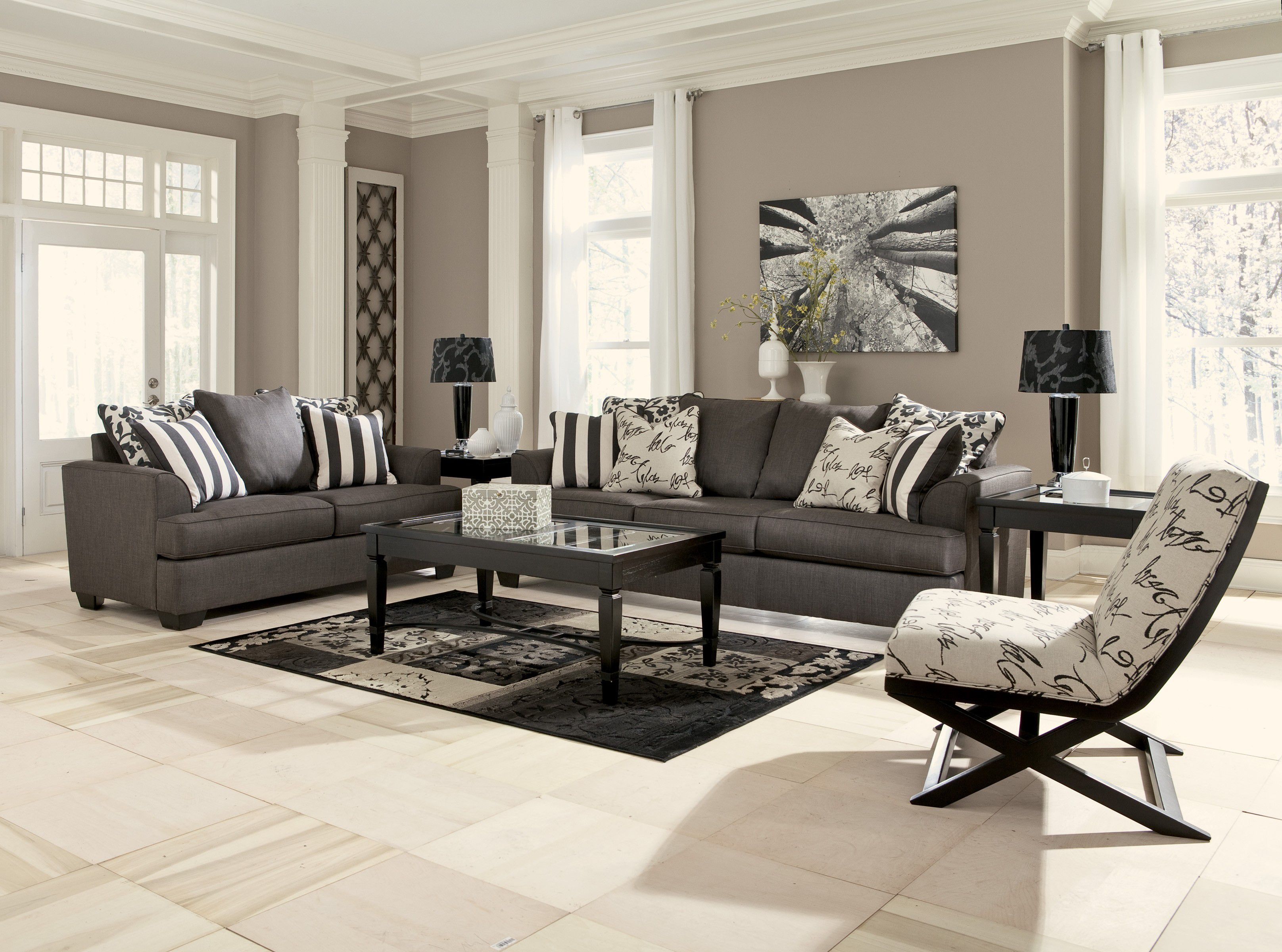 Brilliant Interior for Contemporary Living Room with Grey Sofas and Glass Top Coffee Table on Unique Carpet