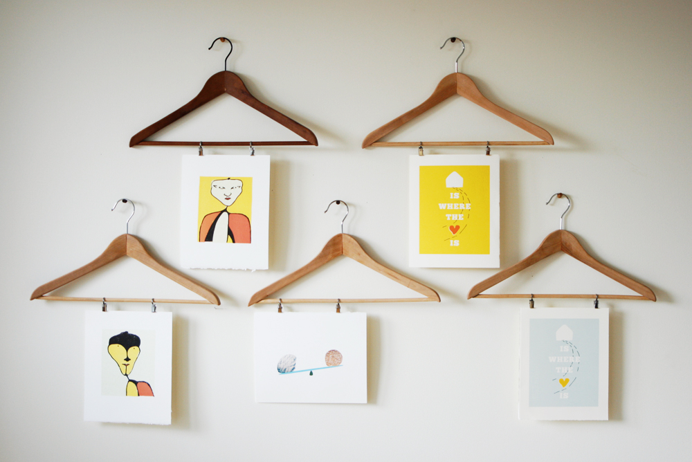 Brilliant Wall Art Ideas using Clothes Hangers and Unusual Photos on White Painted Wall