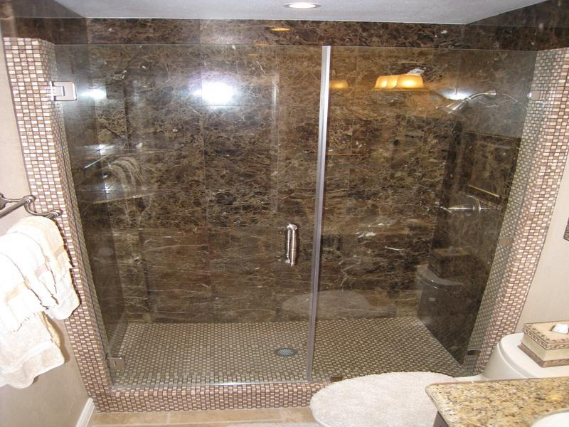 Brown Marble Tile Shower Ideas inside Closed Shower Space with Glass Door and White Ceiling